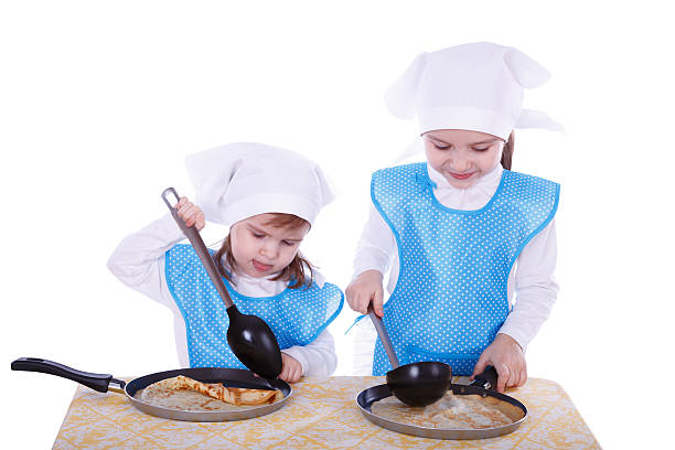 Little children with pancakes stock photo
