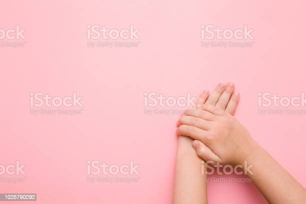 Little childs hands on pastel pink table care about clean groomed picture id1025790292?b=1&k=6&m=1025790292&s=612x612&h=egv9gqfnc2oy78dsleihrc0frl k5dicgqzligiumse=