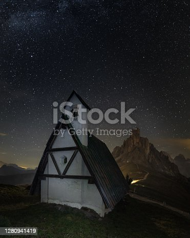 istock Little church under a sky with stars in Passo Giau in Cortina D'ampezzo, famous ski resort in the Dolomites 1280941419