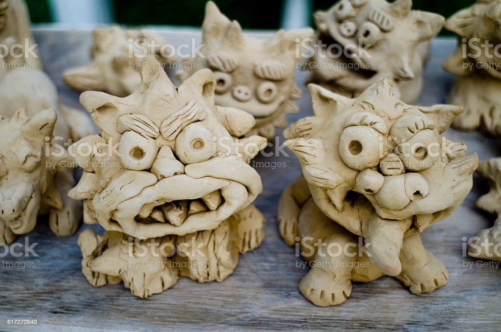 Little clay Okinawan guardian lion dogs freshly crafted in okinawa stock photo