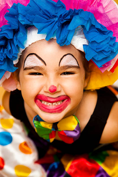 Little clown Little girl dressed as a clown. carnival children stock pictures, royalty-free photos & images