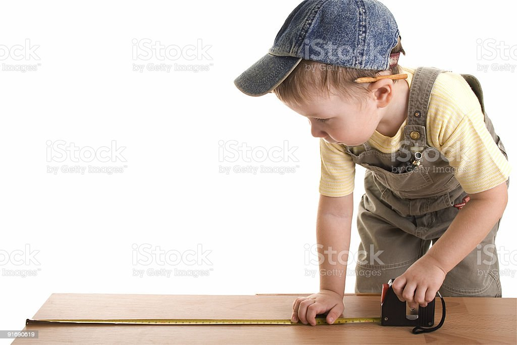 Little construction child with tape-measure royalty-free stock photo