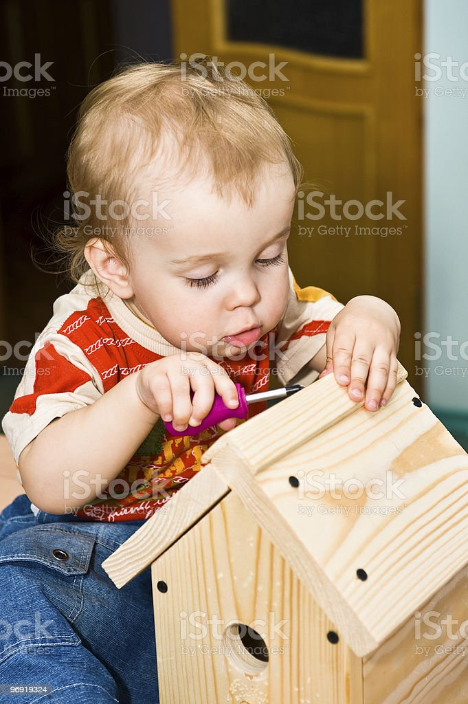 Little construction kid using screwdriver royalty-free stock photo