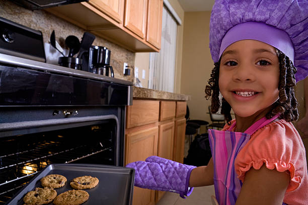 Little cook making meals for later stock photo