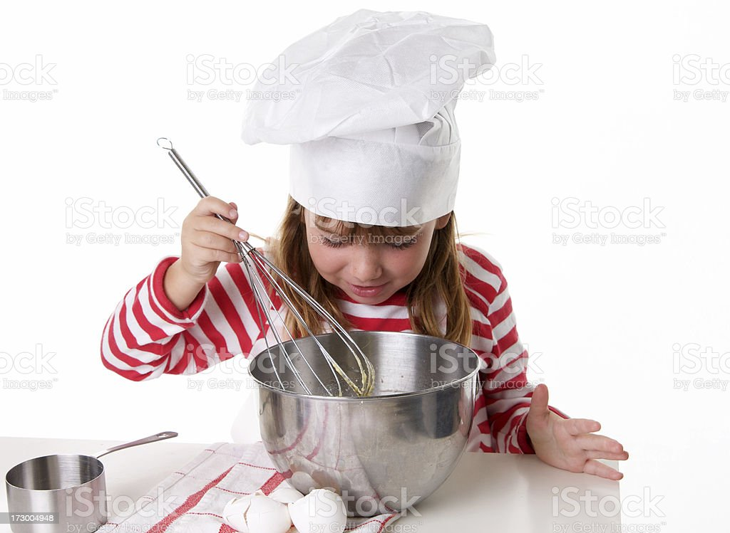 Little Cook Series  - Looking into the Mixing Bowl royalty-free stock photo
