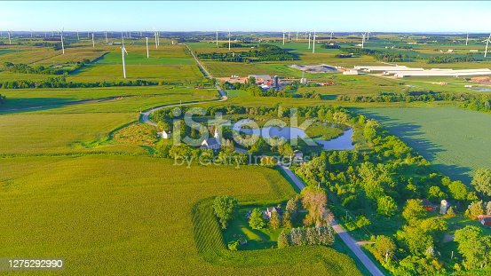 istock Little country church amid corn fields and giant wind turbines 1275292990