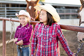 Little cowgirls in a ranch