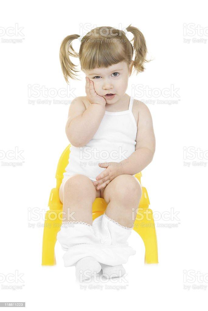 little girls pee Little curious girl on chamberpot isolated stock photo