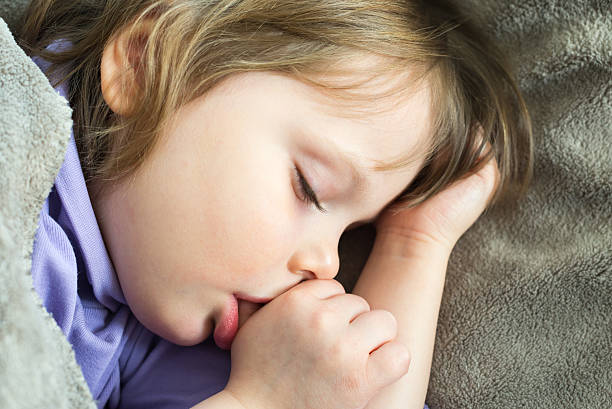 Little cute baby sleeping stock photo