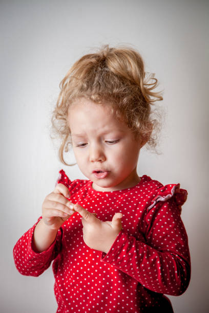 Little cute blond girl playing stock photo