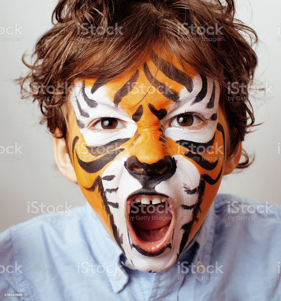 little cute boy with faceart on birthday party close up stock photo