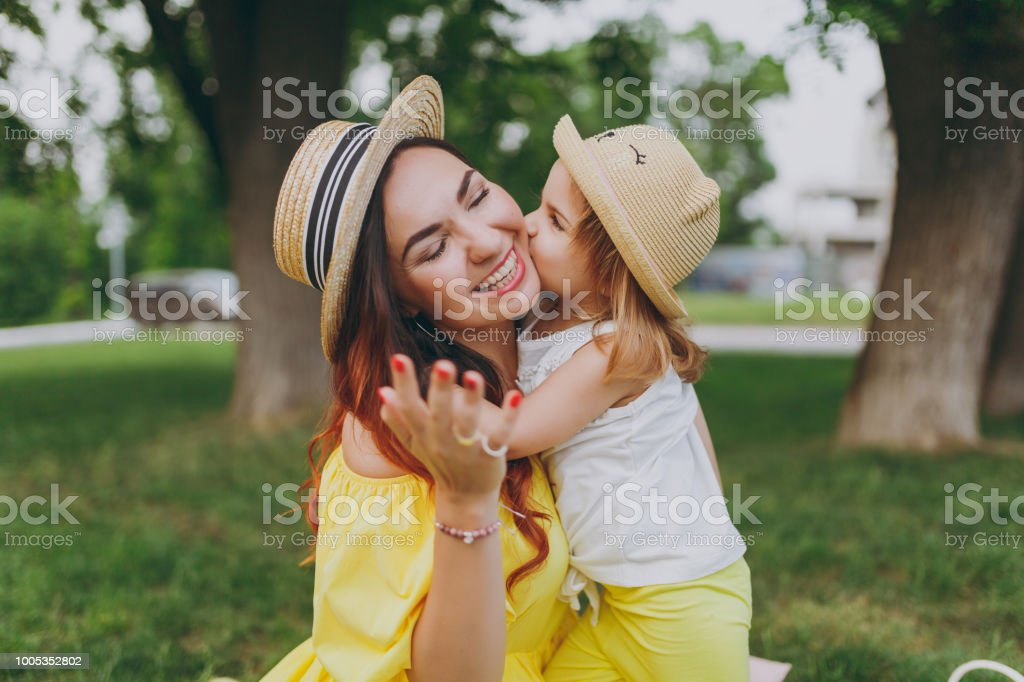 418311c5d938 Little Cute Child Baby Girl Kiss On Cheek And Hug Embrace With ...