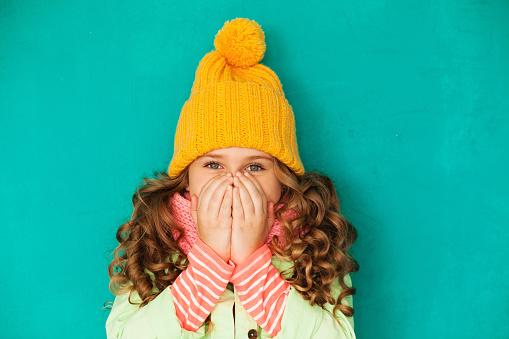 Little cute girl feeling cold