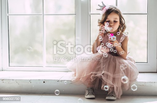 istock Little cute girl in dress 956002732