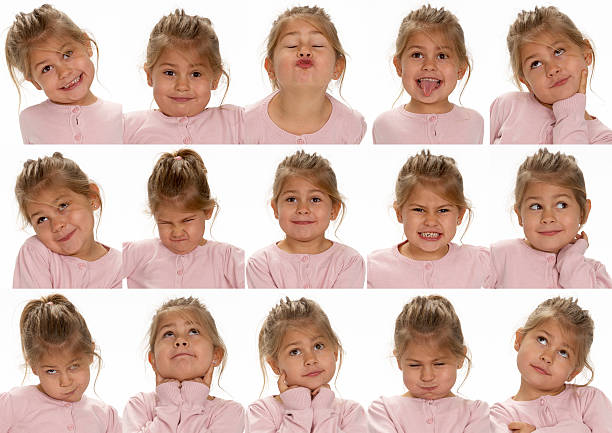 Little cute girl making faces stock photo