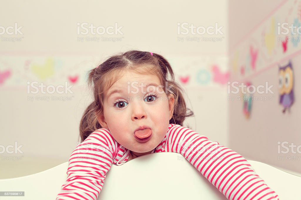 Little Cute Girl Sticking Her Tongue Out Stock Photo
