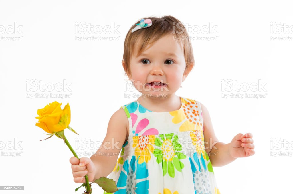 Little cute girl with beautiful yellow rose, romantic gift stock photo