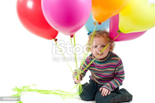 istock Little cute girl with multicolored air balloons 465688661