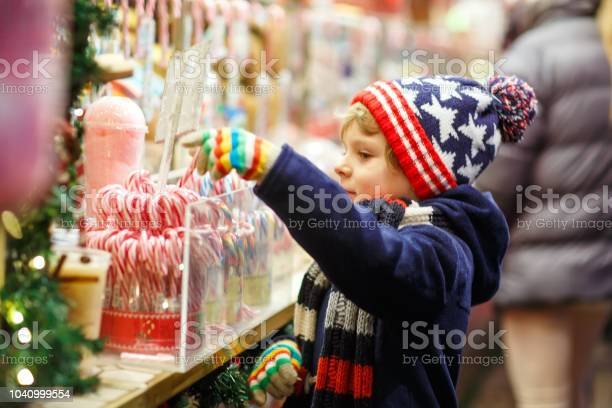 Little cute kid boy buying sweets from a cancy stand on christmas picture id1040999554?b=1&k=6&m=1040999554&s=612x612&h=2ug84c pvtfrysx5i7y5zkxxnvq7vz1mf7svy1usgqi=