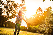 Cute boy imagination about a pilot, nature, sunset