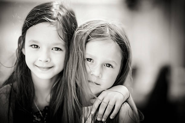 Little cute sisters stock photo