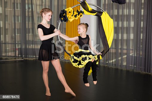 1160198096 istock photo Little dancer in an acrobatic ring 658578470