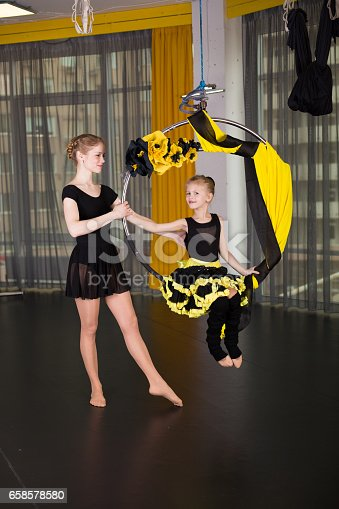 1160198096 istock photo Little dancer in an acrobatic ring 658578580