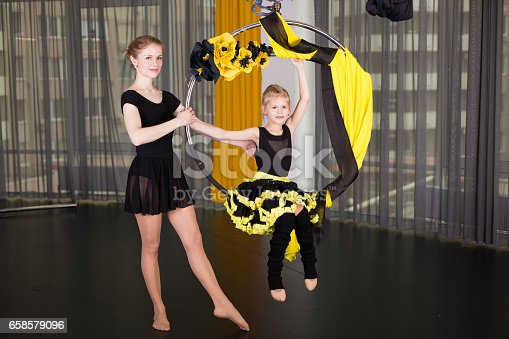1160198096 istock photo Little dancer in an acrobatic ring 658579096
