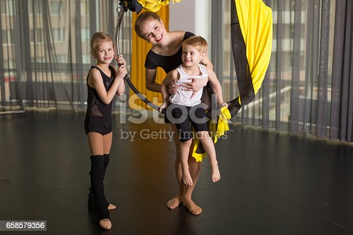 1160198096 istock photo Little dancer in an acrobatic ring 658579356
