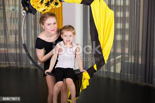 1160198096 istock photo Little dancer in an acrobatic ring 658579574