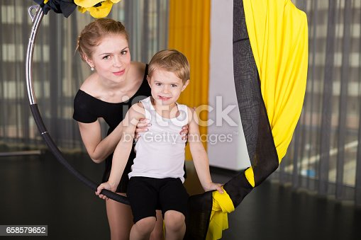 1160198096 istock photo Little dancer in an acrobatic ring 658579652