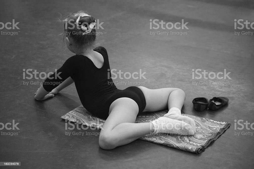 Little dancer stretching royalty-free stock photo