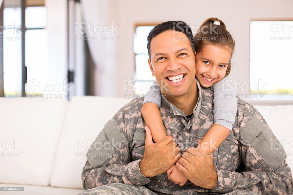 little daughter and military father stock photo