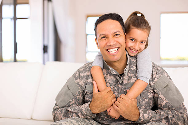 little daughter and military father beautiful little daughter and military father at home military stock pictures, royalty-free photos & images
