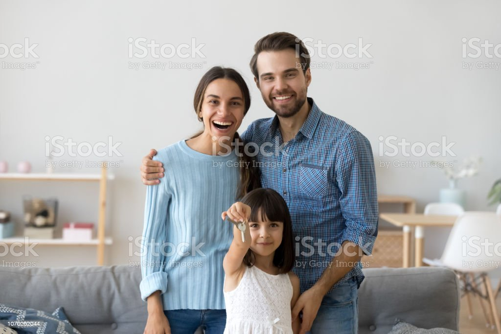 Little Daughter Holding Keys Whole Family Standing In ...