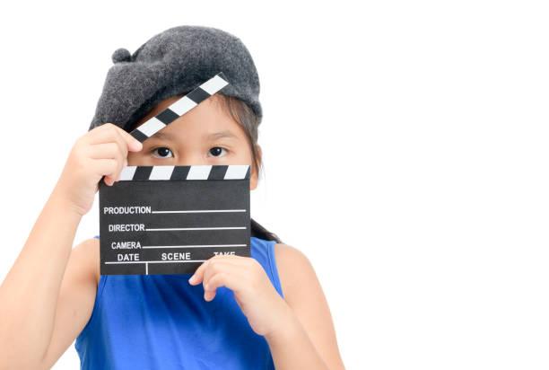 Little Director holding clapper board or slate film stock photo