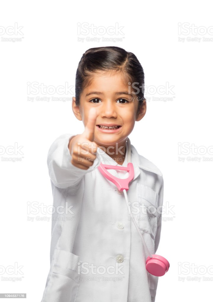 Little doctor giving thumbs up stock photo