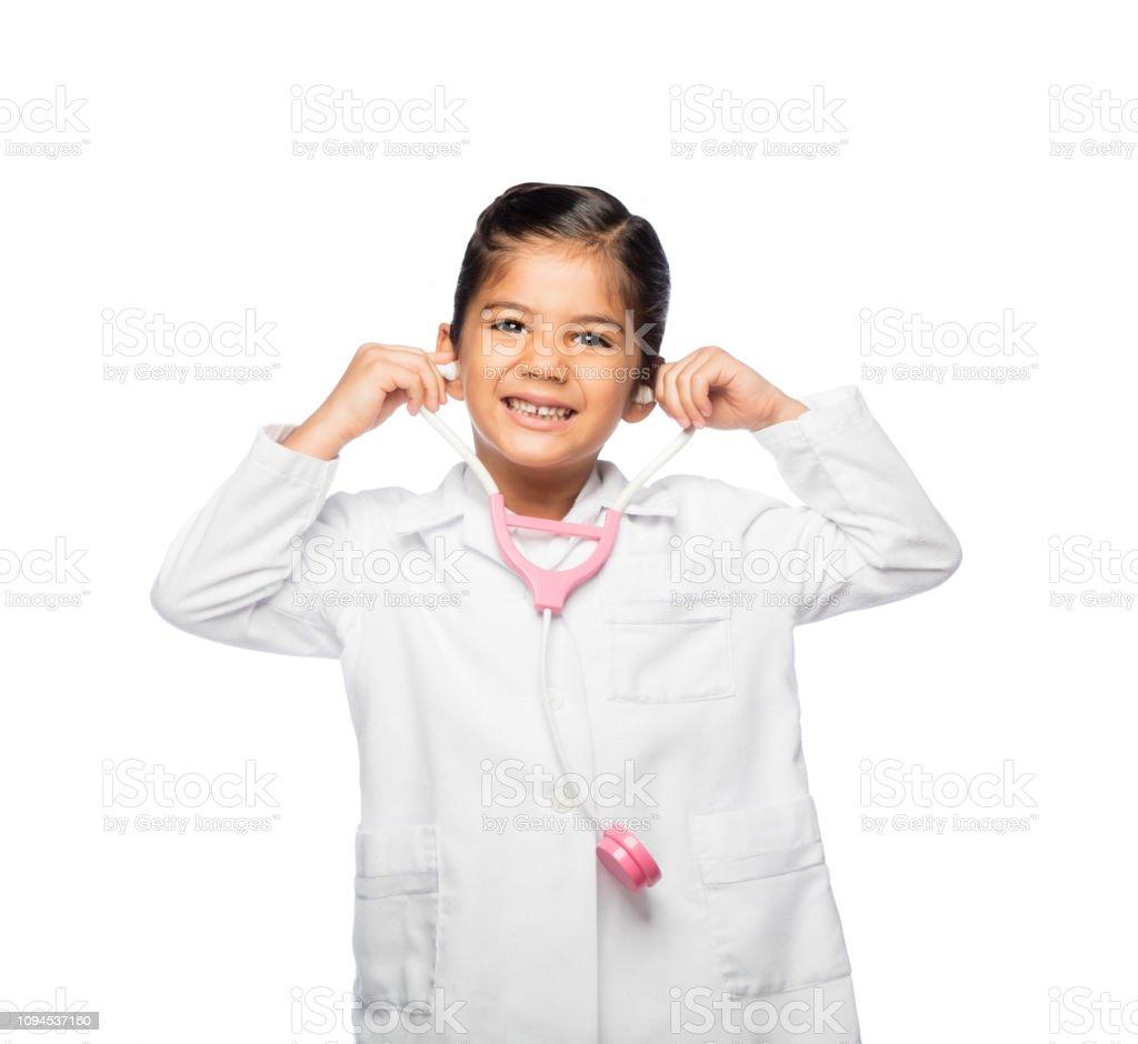 Little doctor holding pretend stethoscope stock photo