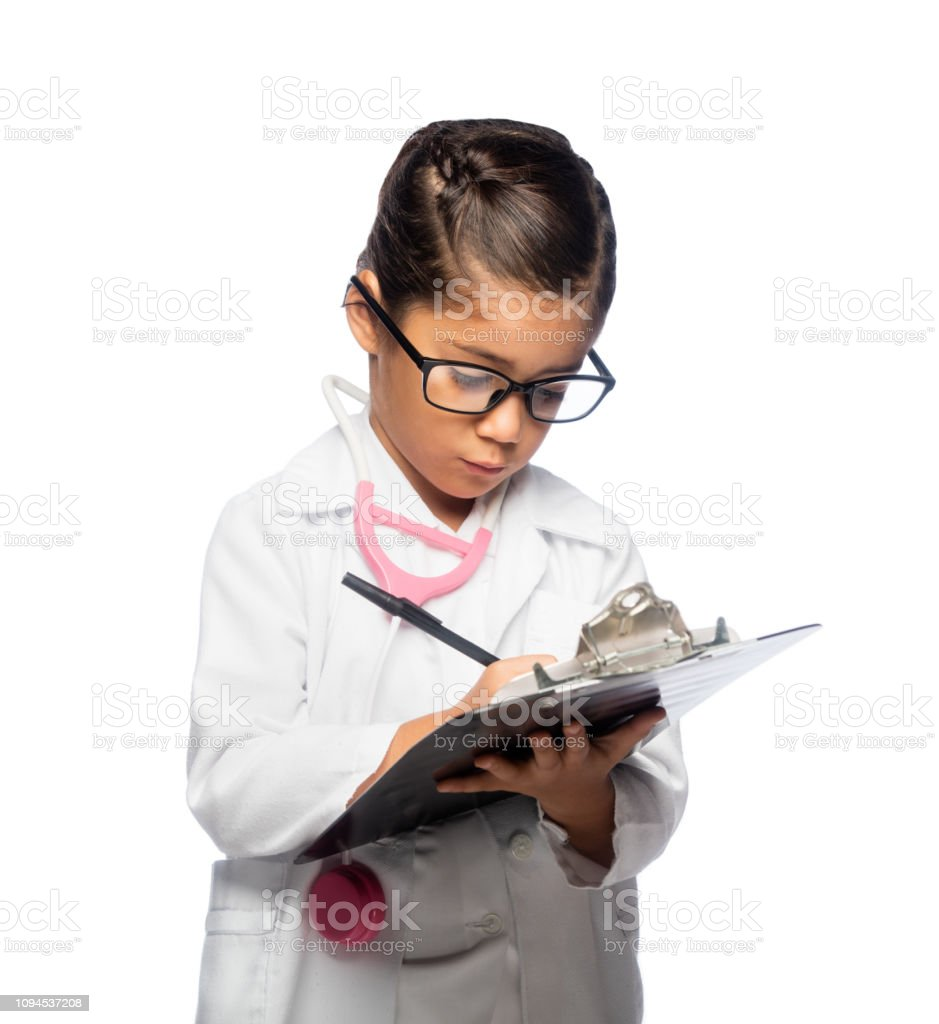 Little doctor taking notes stock photo