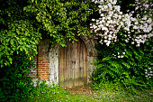 A very small door in the wall of a church graveyard at Hadleigh in Suffolk, England.