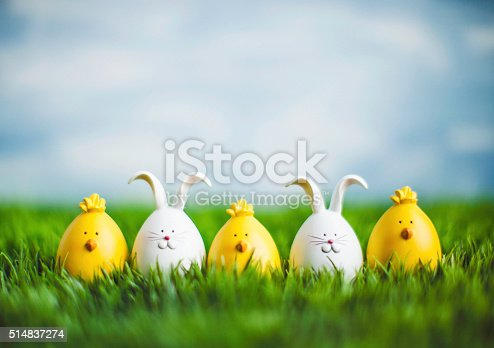 istock Little Easter critters sitting in grass with big blue sky 514837274