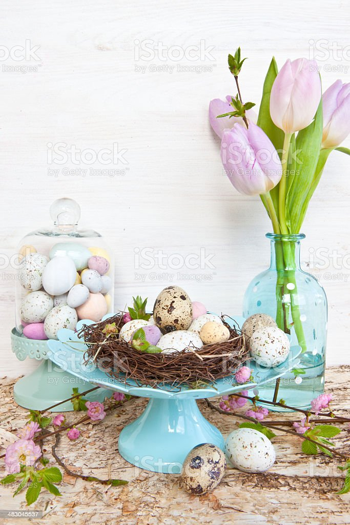 Little easter nest with quail eggs stock photo