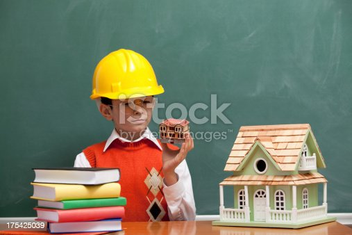 istock Little engineer with helmet designing a new house 175425039