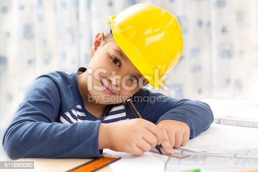 istock Little engineer with helmet 511880090