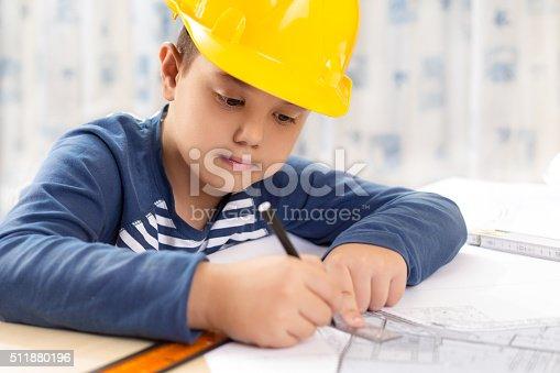 istock Little engineer with helmet 511880196