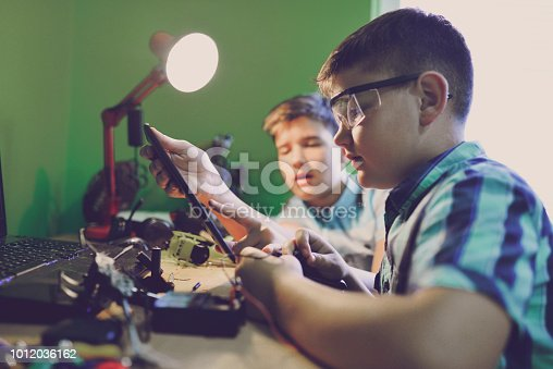 istock Little engineers! Look at this man, this will be a new and better version 1012036162