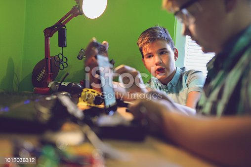 istock Little engineers! Look at this man, this will be a new and better version 1012036312