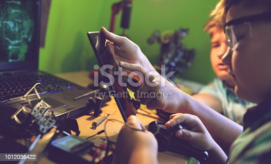 istock Little engineers! Look at this man, this will be a new and better version 1012036422