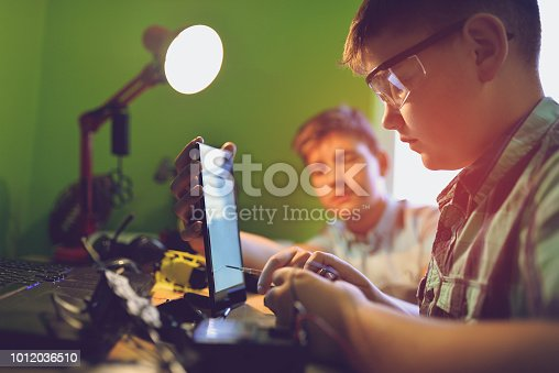 istock Little engineers! Look at this man, this will be a new and better version 1012036510