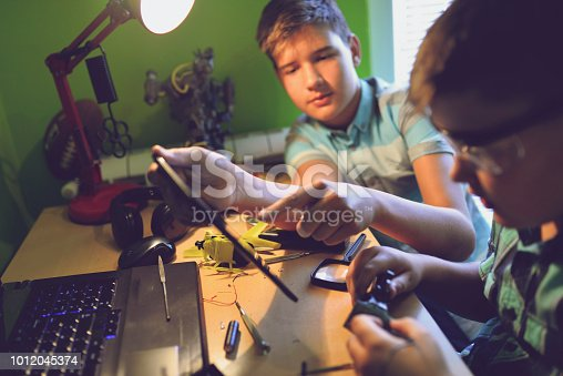 istock Little engineers! Look at this man, this will be a new and better version 1012045374
